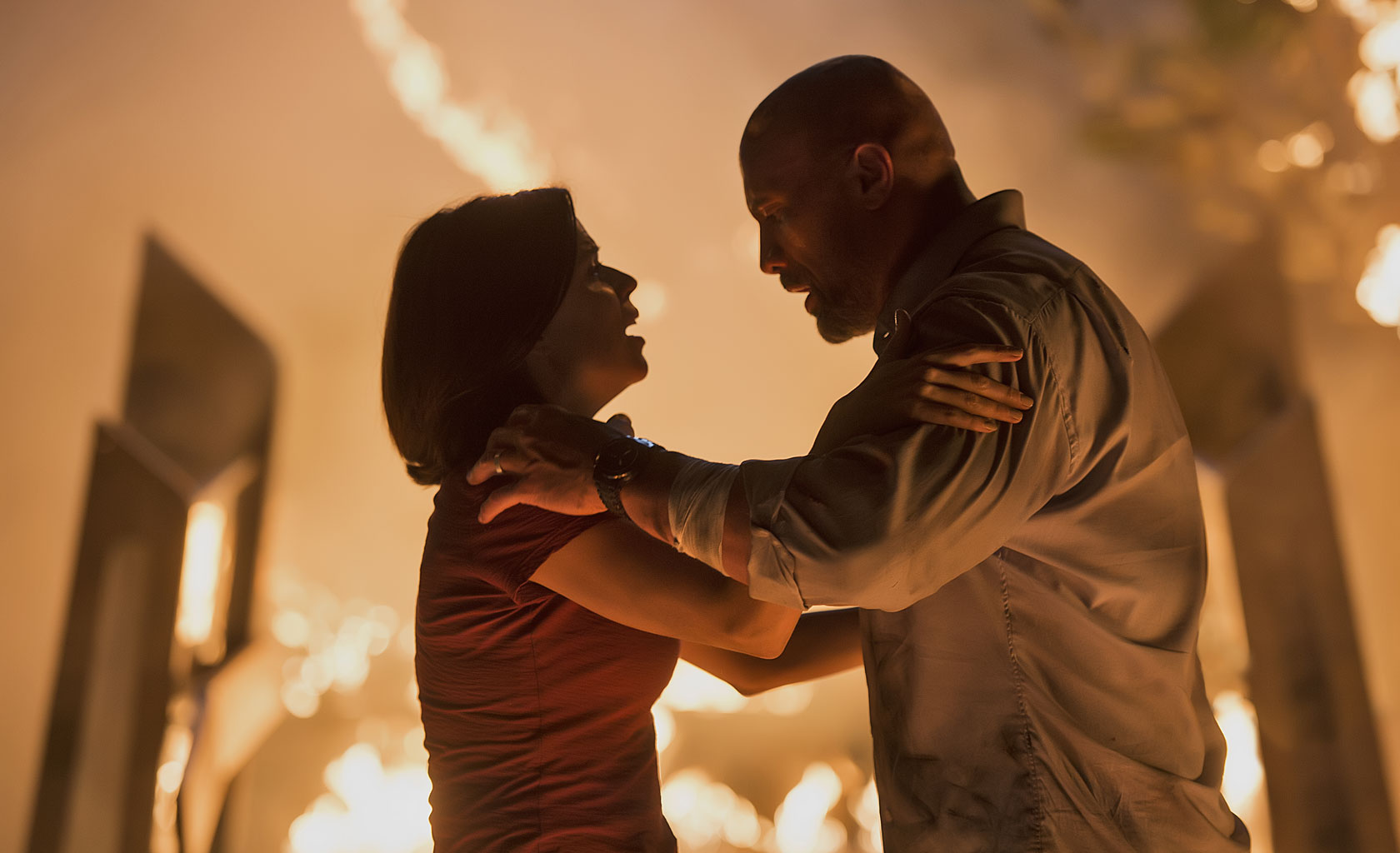 Skyscraper movie image with Dwayne 'The Rock' Johnson and Neve Campbell